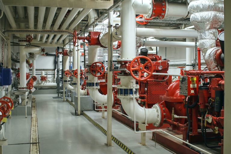 Fire safety in industry. The valve for water supply, fire extinguishing system and pipeline control is painted red