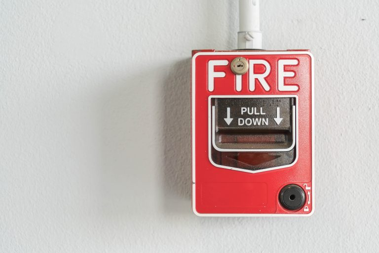 Fire alarm switch on white wall
